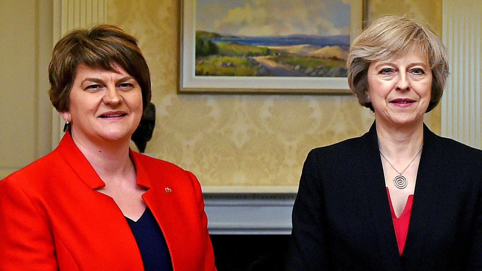 May seeks to allay peace process fears over DUP alliance